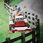 man riding lawn mower
